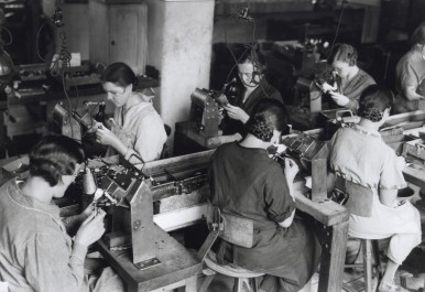 Assembly line production of Bosch spark plugs, 1935