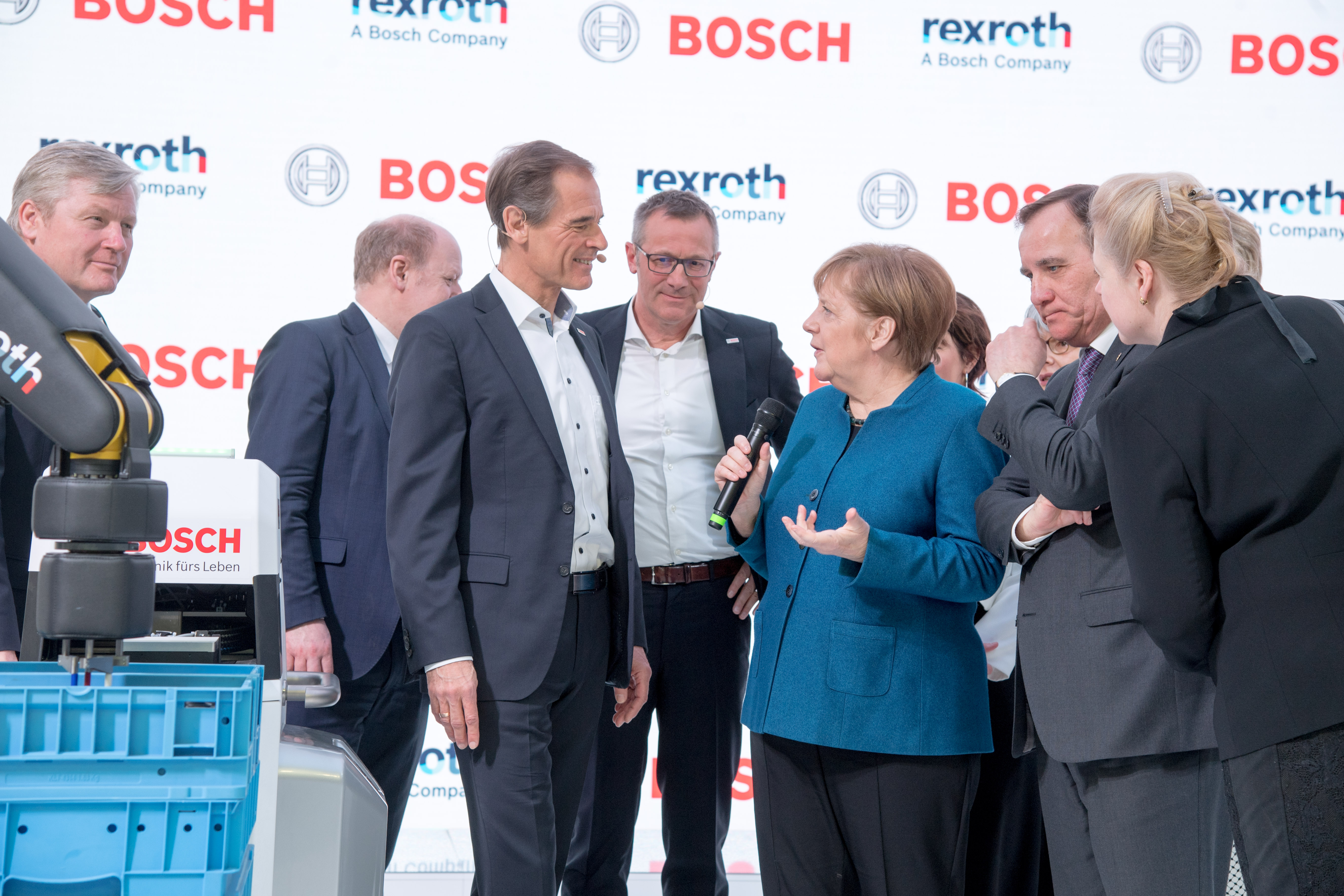 Angela Merkel visits the Bosch booth at the Hannover Messe. Volkmar Denner, chairman of the board of management of Robert Bosch GmbH, explains the factory of the future