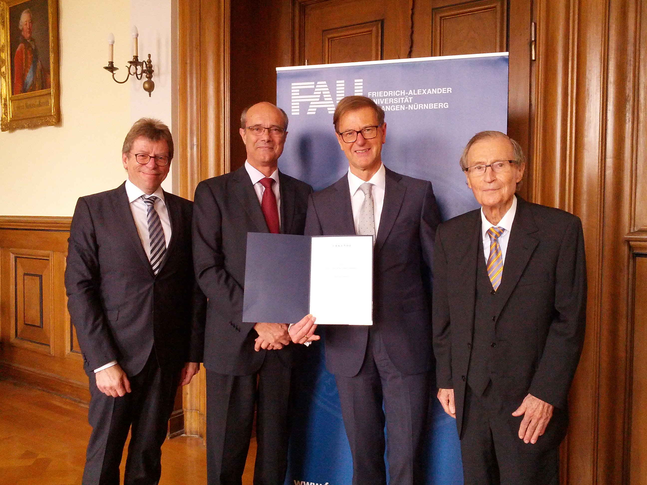 Dr. Stefan Asenkerschbaumer receives the deed  conferring the title of honorary professor.