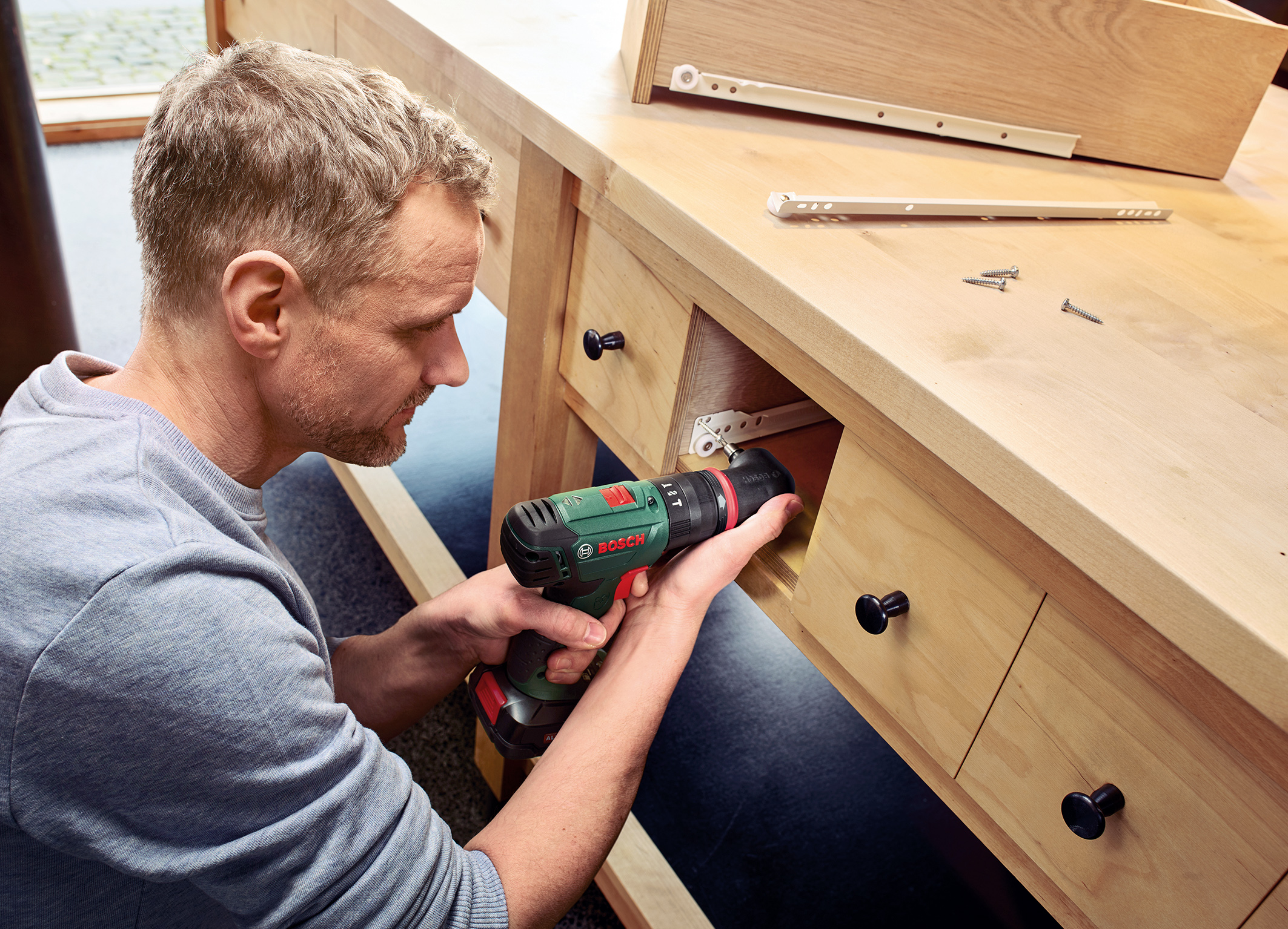 Cordless combi drill system for DIYers: Bosch AdvancedImpact 18 QuickSnap with angle screw adapter
