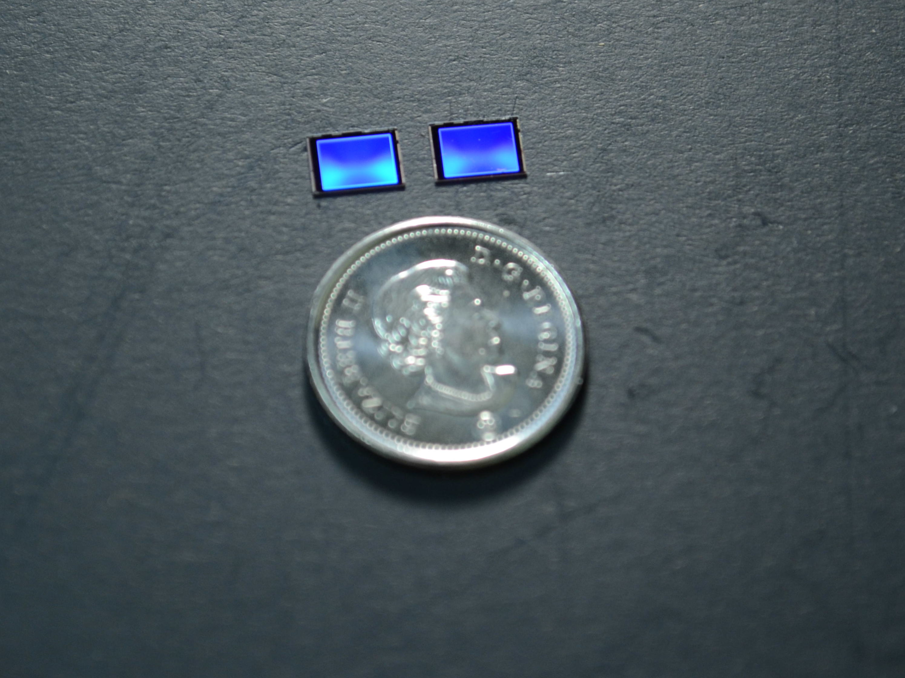 Two 5x7 mm imager chips - a bare one that is 2D and another with AIRY3D's patented TDM that is 3D