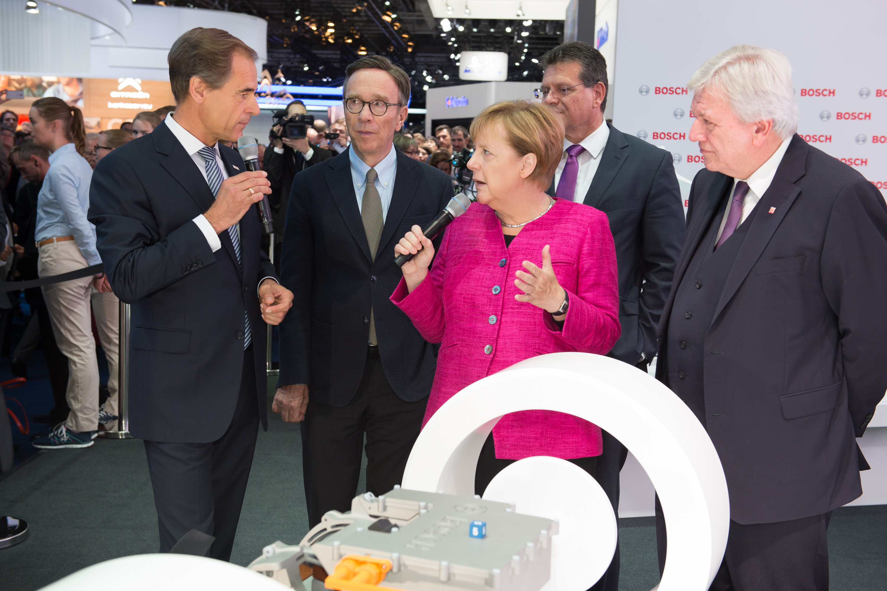 Bosch-CEO Dr. Volkmar Denner welcomes chancellor Angela Merkel at the Bosch booth at IAA 2017.