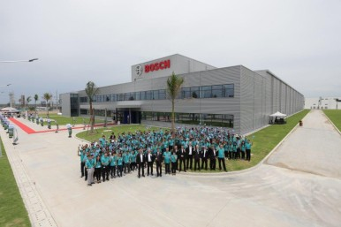 Group photo in front of the new plant