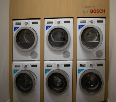 Sustainable washing and drying in communal laundry rooms